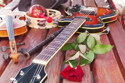 Electric and acoustic guitar,violin, flute and red rose