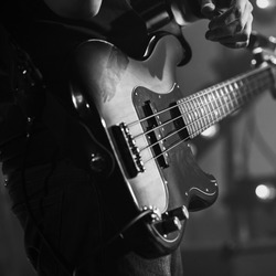 Electric bass guitar, live music theme. Retro stylized square black and white photo