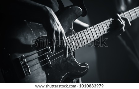 Electric bass guitar player hands, live music theme, black and white photo Foto d'archivio ©