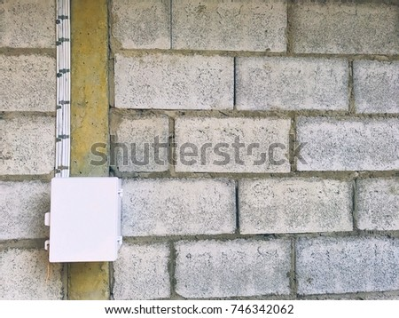 Electric box and wire on the brick wall background #746342062