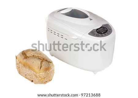Electric bread maker and one fresh bread isolated on a white background