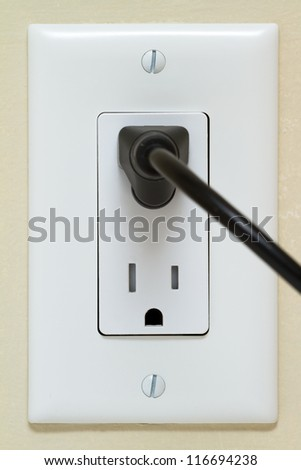 Electric cable in Electrical Outlet on the Wall. Power 110v
