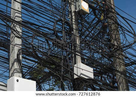 Electric  cables   telephone  cables  and  inter  cables  on  electric  pole  at  Koh  Samui #727612876