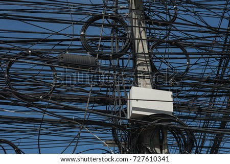 Electric  cables,  telephone  cables  and  internet  cables are  on  electric  pole  at  Koh  Samui #727610341