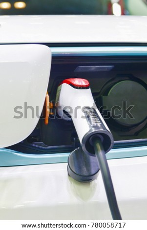 Electric car charger on charging with connection plug and socket. #780058717