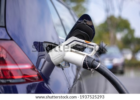 electric car charging in power station Stockfoto ©