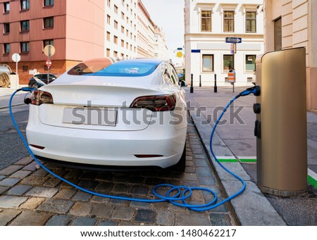 Electric Car Charging station in Vienna, Austria. Battery hybrid vehicle eco charger. Future energy power. Green technology. Plug Transport. Recharge. Clean ecology concept. Modern supply Mixed media Stock photo ©