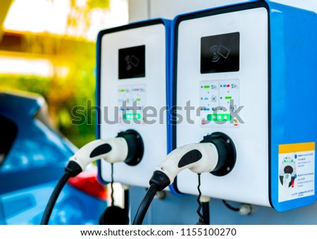 Electric car charging station. Plug for vehicle with electric motor. Coin-operated charging station. Clean energy power. Commercial charging station. Charging point. Infrastructure policy.  #1155100270