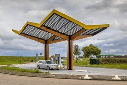 Electric car filling at electricity charge station in the fast expanding car charging network in the Netherlands