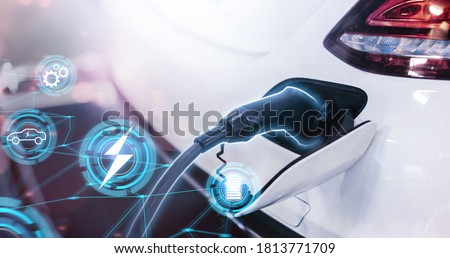 Electric car power cable plugged into car charging station booth futuristic modern technology loading electricity energy, power supply battery charge energy electro mobility eco environment-friendly