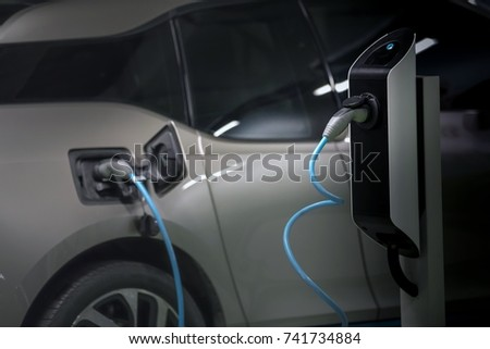 Electric cars charged on a charging station #741734884