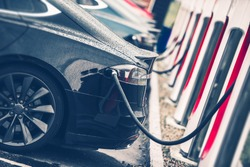 Electric Cars Charging Station Closeup Photo. Vehicle Rechargeable Batteries Charing. Future of Transportation.