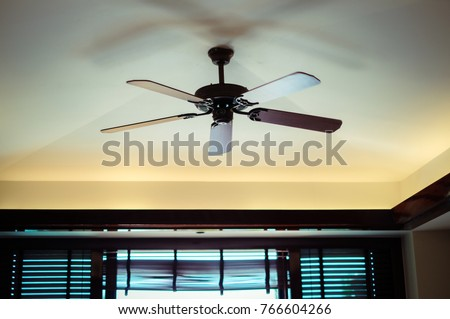 Electric ceiling fan. Ceiling fan indoors