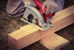 Electric circular saw for a wood cut.