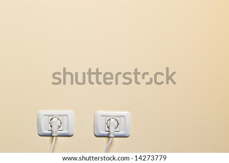 electric consumption - two socket on beige wall