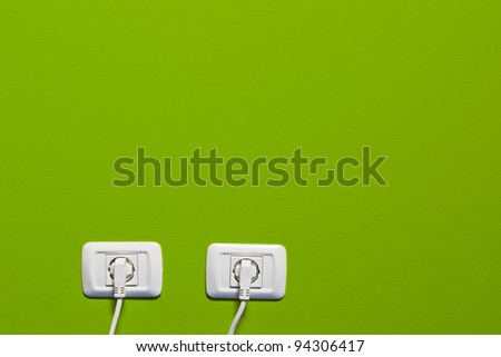 electric consumption - two socket on green wall