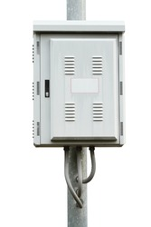 Electric control box on iron pole isolated on white background