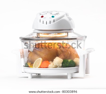 Electric convection oven with whole chicken inside