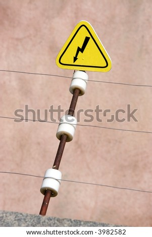 Electric danger sign. High-voltage wire.