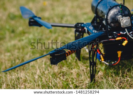 Electric drone engine with black blades on background field. #1481258294
