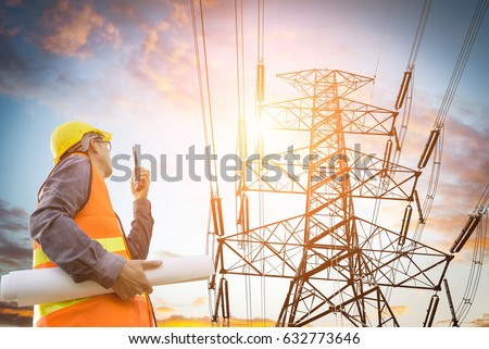 electric engineer inspect the high voltage pole Stock photo ©