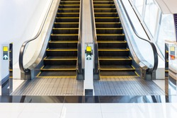 Electric escalator or moving staircase and tile floor. For carry people between floor i.e. shopping mall, airport, underground, office, metro and subway. Can mockup your banner design in modern look.