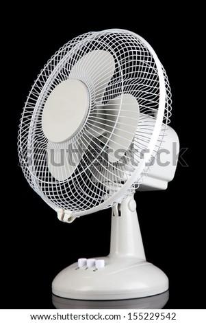 Electric fan on black background