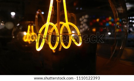 Electric filament glows brightly #1110122393