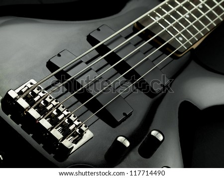 Electric five string bass guitar closeup, for music, entertainment themes - stock photo