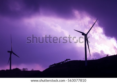 Electric generated Machine. Wind turbine with background purple sky . Free energy by wind turbine.