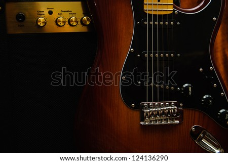 Electric guitar and amplifier on the background