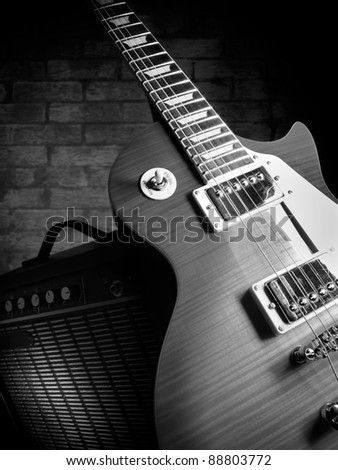 electric guitar and amplifier with brick wall in the background,closeup, for music and entertainment themes