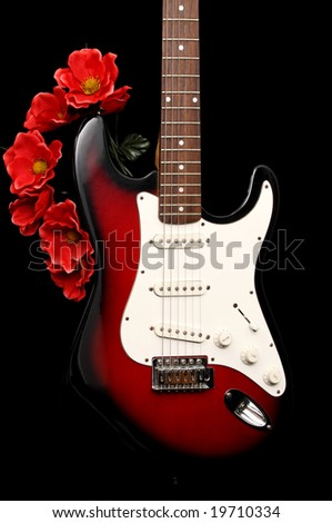 electric guitar and fake red flowers black background stock photo 19710334 shutterstock. Black Bedroom Furniture Sets. Home Design Ideas