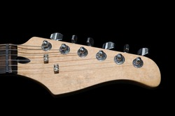 electric guitar headstock isolated on black background