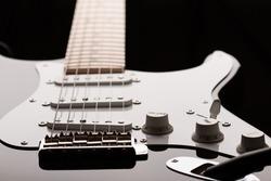 Electric guitar in dark key at unusual angle