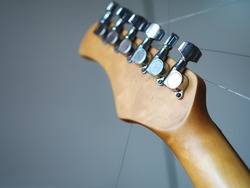 Electric guitar neck & head with strings sting out
