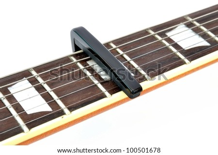 Electric guitar neck with a capo