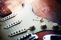 Electric guitar  on a grungy old wooden surface with impressional feeling.
