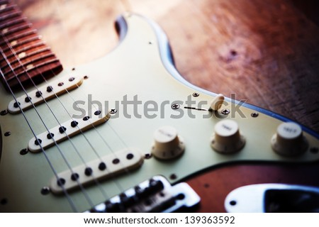 Electric guitar  on a grungy old wooden surface with impressional feeling. #139363592