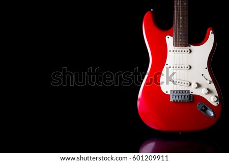 Electric guitar on black background. Free space for text