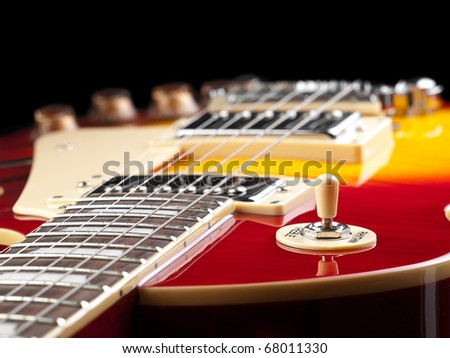 electric guitar over black background, low angle shot, for music and entertainment themes