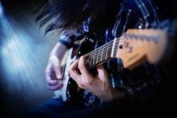 Electric guitar playing. Young men playing electric guitar. Closeup Photography.