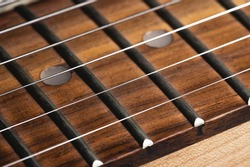 Electric guitar strings close-up. Music macro background