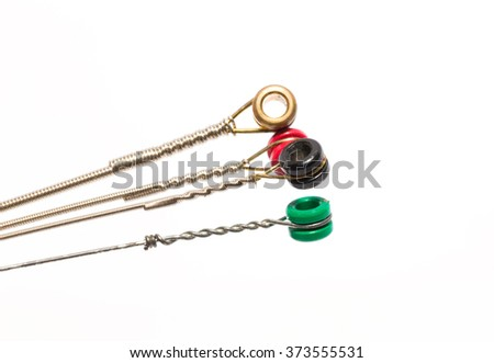 electric guitar strings isolated on white background