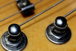 Electric guitar tuners with strings - close up - macro