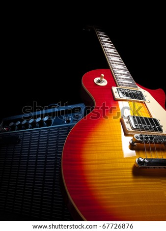 electric guitar with amplifier,over black background,  for music and entertainment themes