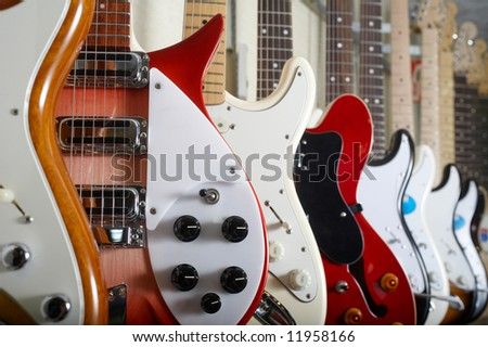 Electric guitars hanging on wall