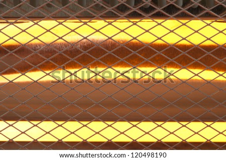 Electric heater with halogen coils close up. Luminous halogen coils background - stock photo
