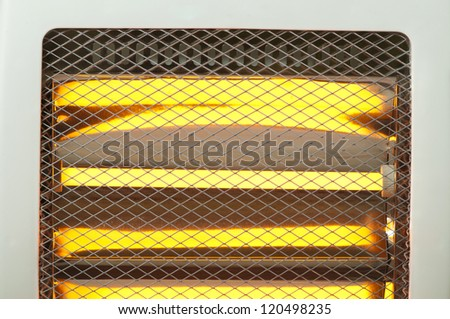 Electric heater with halogen coils close up. Luminous halogen coils background