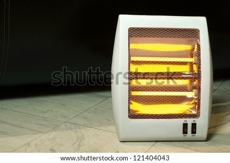 Electric heater with halogen coils. Heater on marble slabs